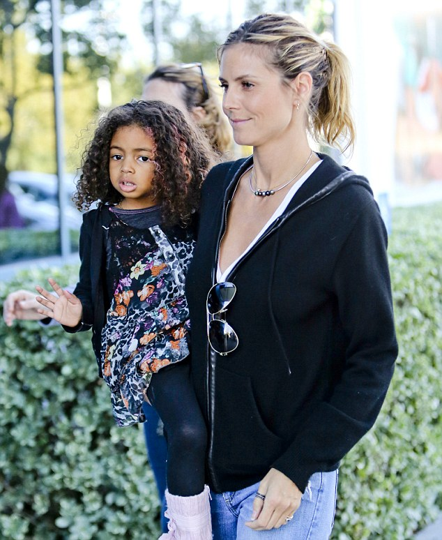 Her favourite place: Lou, who's father is pop singer Seal, was spotted on Friday clinging to her mother Heidi Klum during the pair's Starbucks outing and then later in Irvine