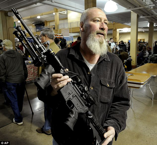 Eager to buy: Gun collector and target shooter Roy Shanks paid $2,400 for a Smith and Wesson-made variation of the AR-15 rifle that would have cost about $1,300 a month ago in case Washington passes a weapons ban