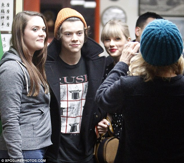Back together: Harry is flying to Boston so he can spend New Year's Eve in New York with Taylor, where she will perform alongside Justin Bieber