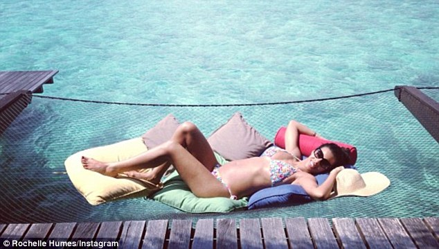 'Bump at sea': Rochelle Humes shows off her tiny bump as she poses in a bikini on honeymoon in the Maldives