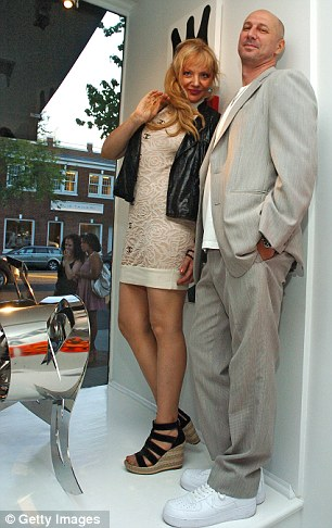 Tragic: Marijana Bego and artist Eric Haze pictured at an exhibition in 2010. Ms Bego plunged to her death from the top of the building which housed her own gallery