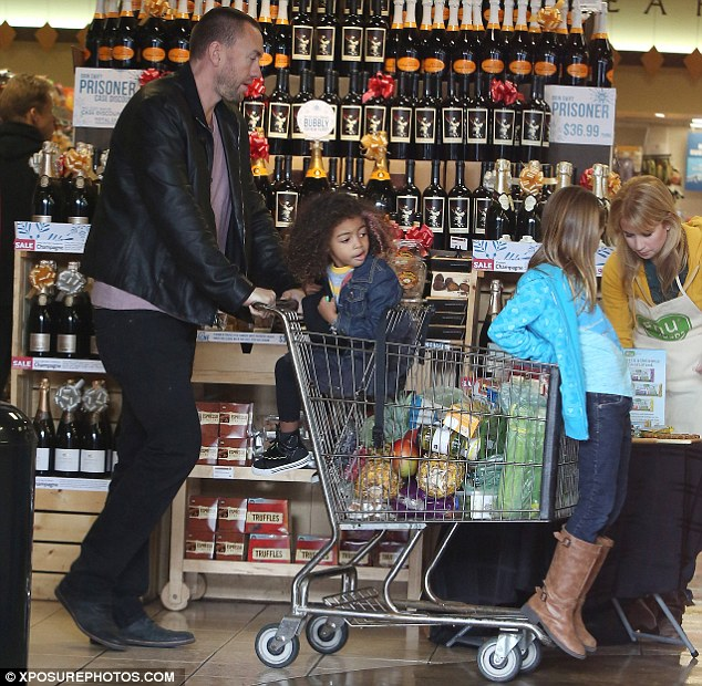 Supportive: Martin kept a close eye on the girls as they enjoyed their shop