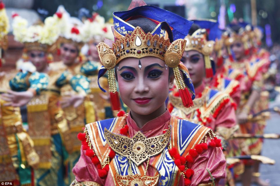 Balinese dancers perform as they take part in a cultural parade during a New Year's Eve celebration