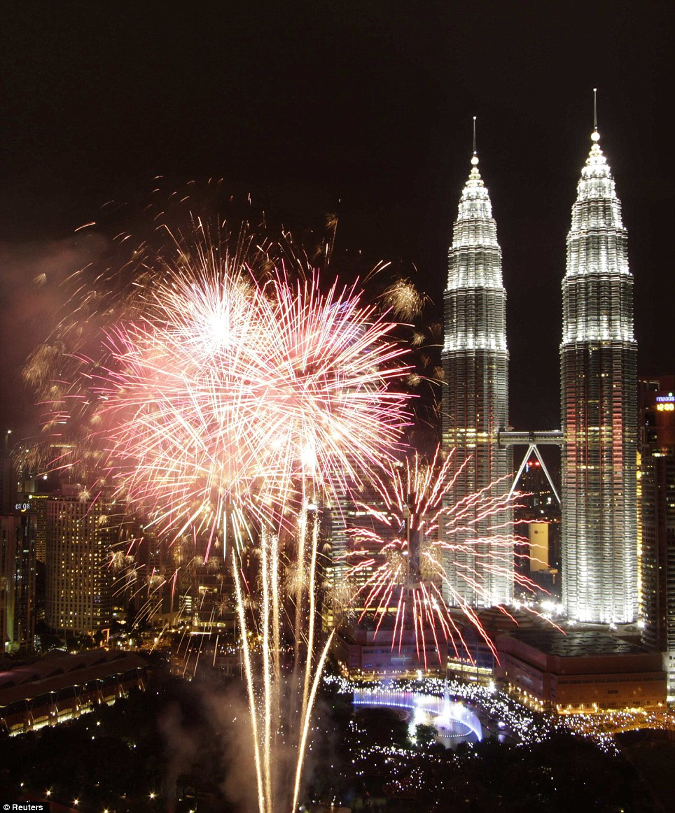 Exciting: Fireworks explode near Malaysia's landmark Petronas Twin Towers during New Year celebrations in Kuala Lumpur