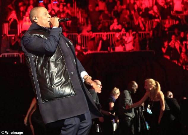 Look who it is! Gwyneth Paltrow (bottom right) was seen on stage as Jay Z performed at the Barclays Center in Brooklyn