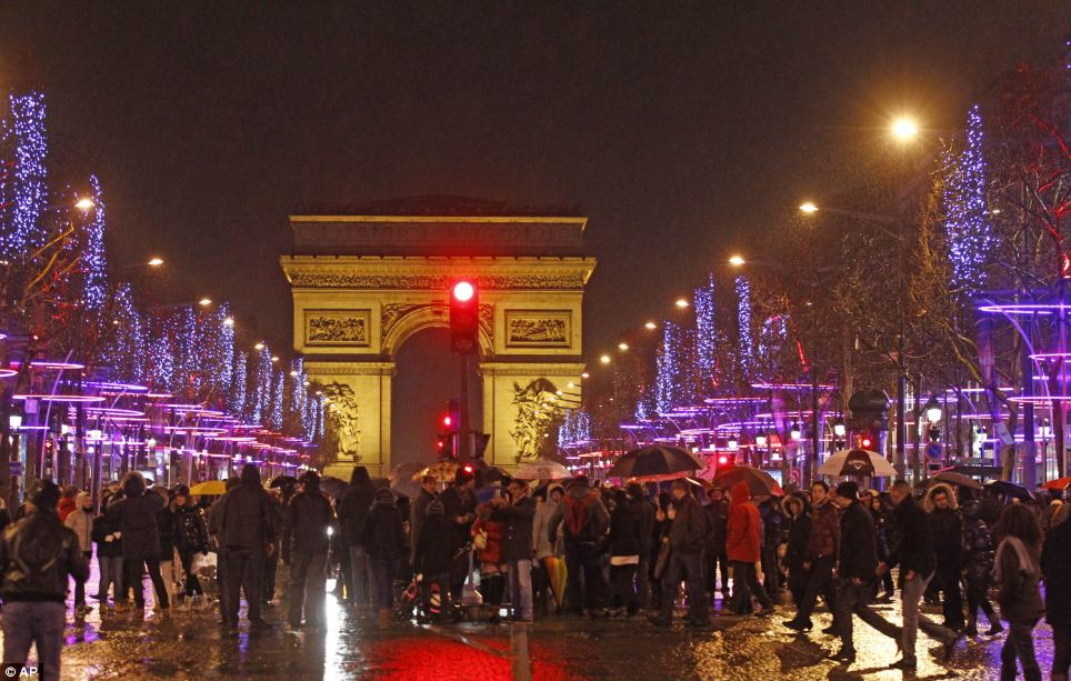 Revellers take to the Champs Elysee to see in the New Year in Paris, France