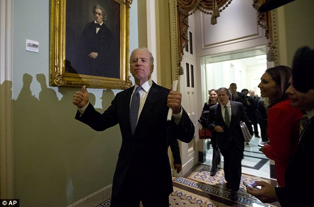 Jubilant: Vice President Joe Biden gives two thumbs up following a Senate Democratic caucus meeting about the fiscal cliff