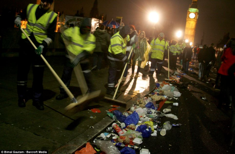 Cleaners clean the rubbish at Westminster Bridge