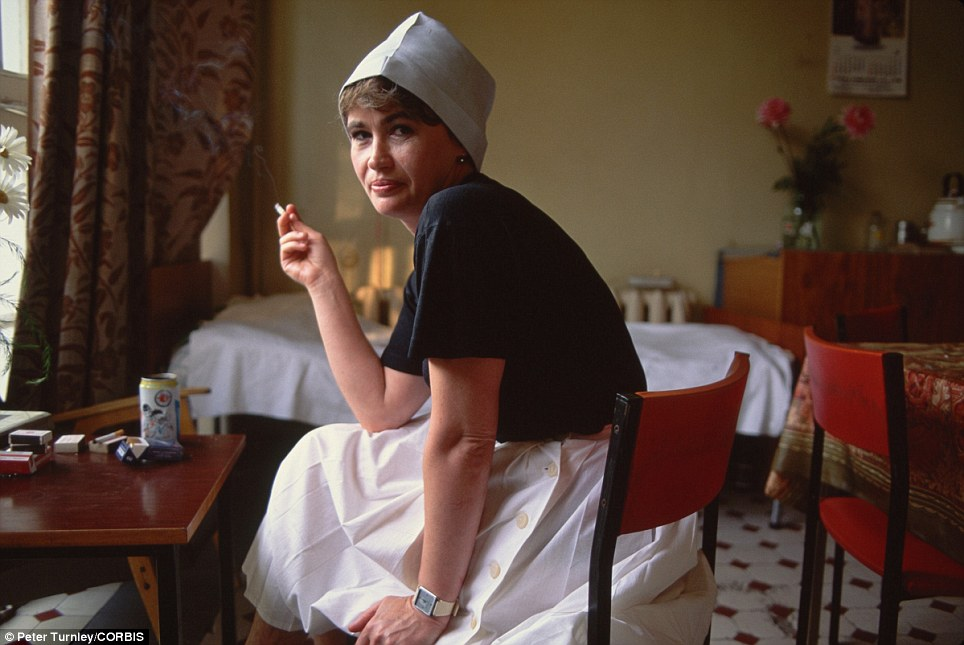 Taking a breather: Hospital nurse Ludmilla Subocheva smokes on her break in the dining room