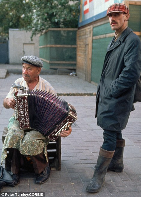 An accordionist performs on Arbat Street, a popular pedestrian thoroughfare