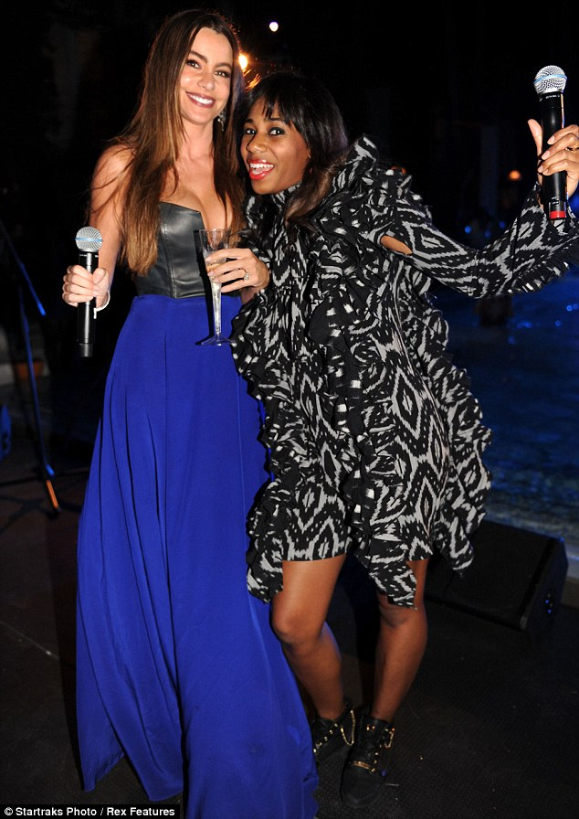 Bosom buddies: Vergara and singer Santigold ham it for the camera, microphones in hand