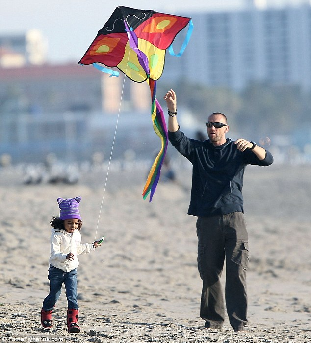 Let's go fly a kite: Martin helps Lou get airborne