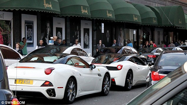 Turning heads: These two supercars are seen driving in Knightsbridge, central London, outside Harrods