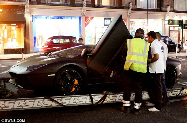 Taken away: Mr Al Rashed's Lamborghini is seized by police for allegedly not having the correct insurance