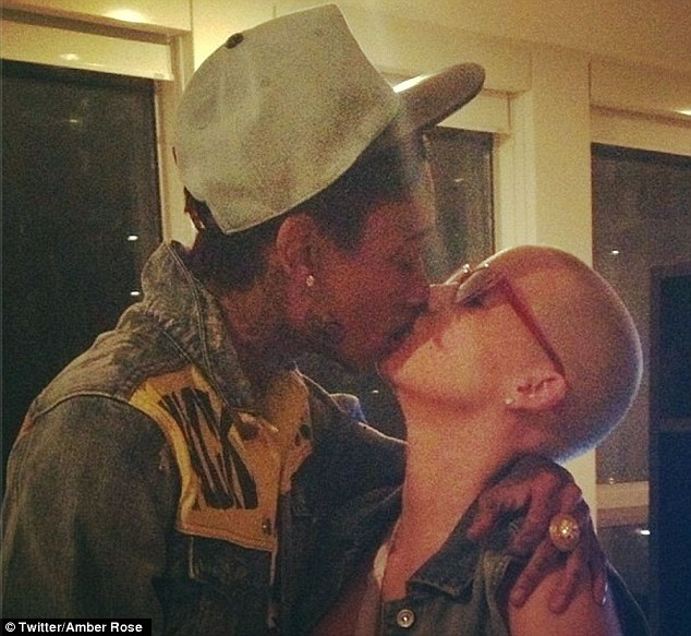 New Year kisses! Amber Rose cosies up with Wiz for a January smooch