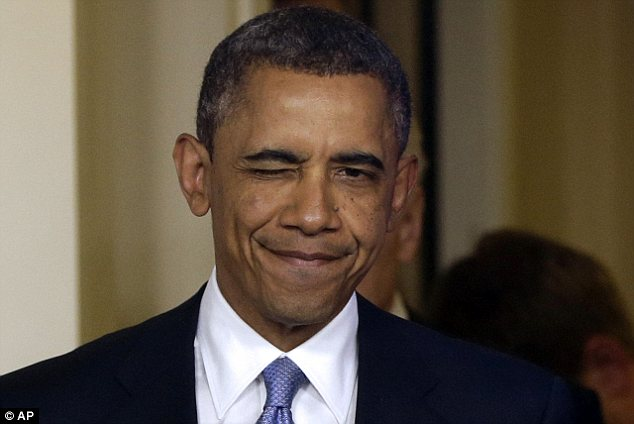 Smirk: President Barack Obama winks as he arrives to make a statement regarding the passage of the fiscal cliff bill in the Brady Press Briefing Room at the White House