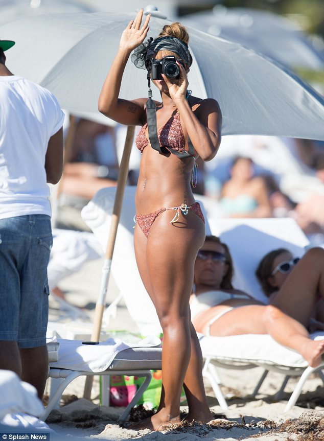 Snap happy: Alexandra Burke turns the tables on the paps by taking a few candid shots herself