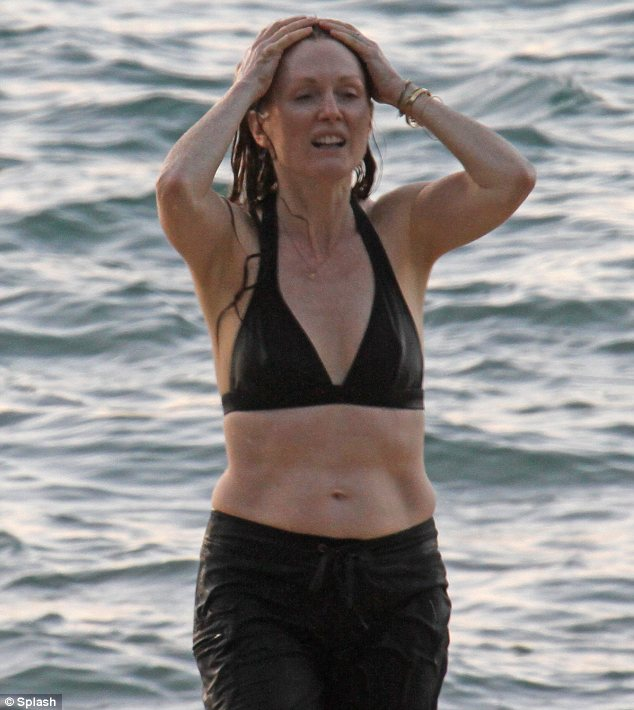How refreshing! The 52-year-old star was seen smoothing back her hair as she enjoyed the waves