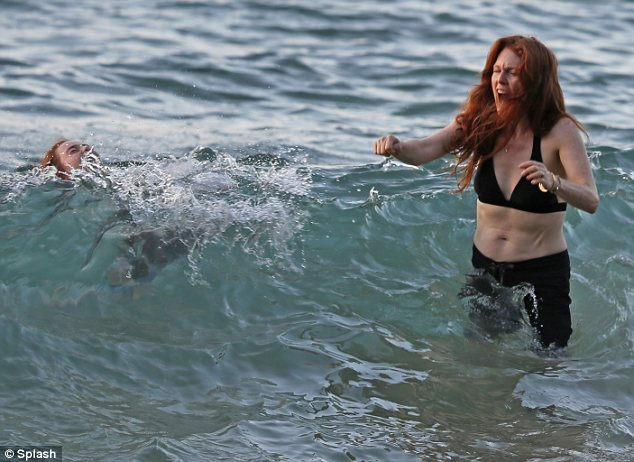 Making a splash: The actress and her 10-year-old daughter Liv were seen enjoying the sea together
