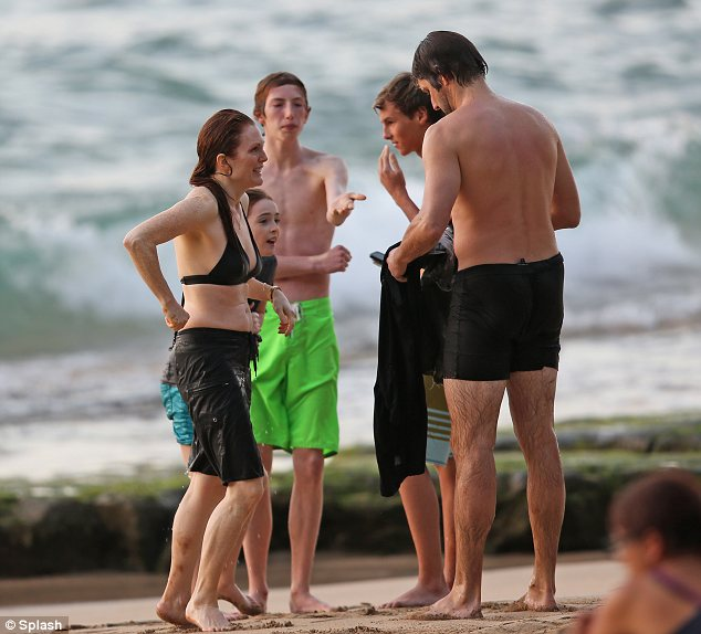 Group discussion: The family were seen chatting away on the beach after their dip