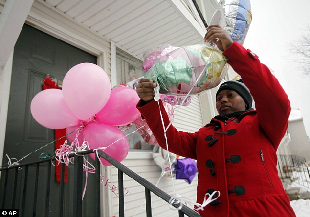 Memorial: Family and friends tied balloons on the door step of the Greene's home at the Martin Luther King Apartments, in Detroit, after the stabbing