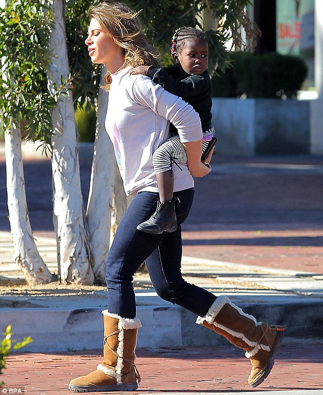 Taking strides: The TV star wrapped up against the chilly Los Angeles temperatures in jeans, a sweater and warm boots