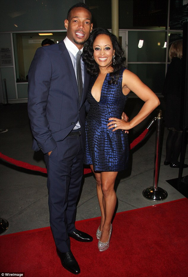 Walking the red carpet: Marlon Wayans and Essence Atkins attend the premiere