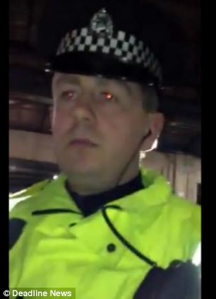 A police officer is being investigated over a video which shows him knocking a mobile phone out of the hands of a member of the public