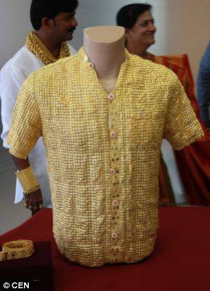 Work of art: Money-lender Datta, 32, from Pimpri-Chinchwad, says the shirt took a team of 15 goldsmiths two weeks to make working 16 hours a day creating and we