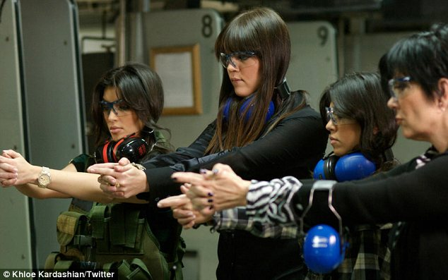 Fierce four: Khloe Kardashian tweeted an old snap of her, Kris and her sisters at a gun range
