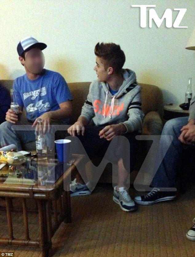Cause for controversy: Justin Bieber was photographed holding a cigarette during a party in Newport Beach, California on January 2