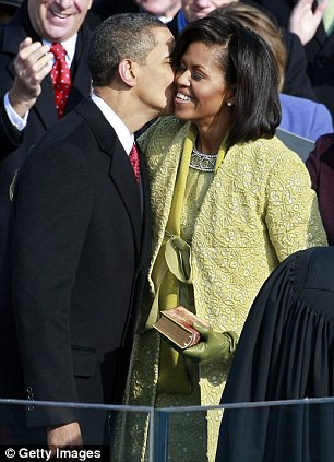 Sealed with a kiss: President Obama kisses his wife Michelle after he is sworn in as the 44th president of the United States during the 2009 ceremony