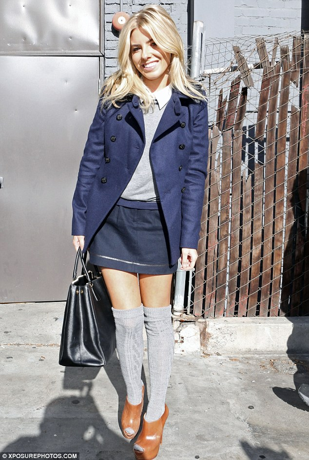 Schoolgirl chic: Mollie King wore a miniskirt and knee socks as she joined The Saturdays promoting their new reality show in Los Angeles