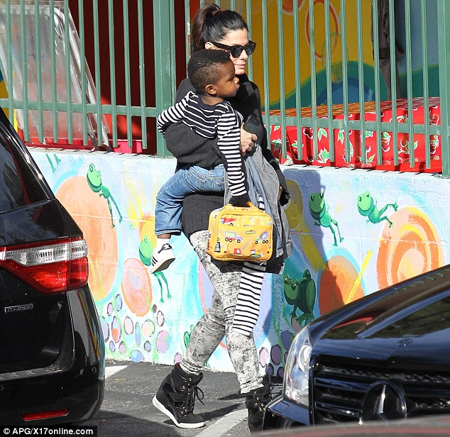 Sandra Bullock was spotted picking up her son Louis from school in Los Angeles on Monday - showing off his trendy Mohawk hair cut