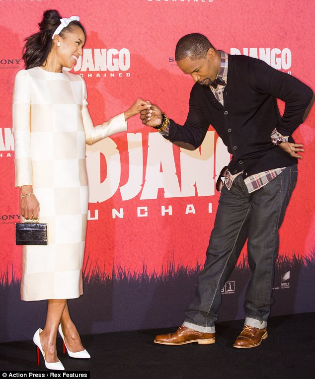 What a gentleman: Jamie Foxx shows off his good manners as he bows to co-star Kerry Washington at a photocall for Django Unchained in Berlin