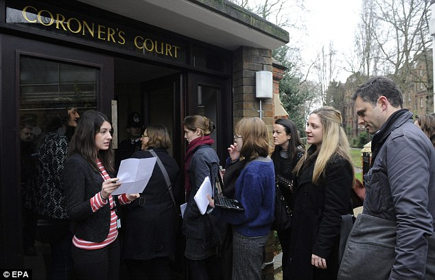 Crush: Journalists wait to enter a new inquest, which also found that Ms Winehouse died from misadventure