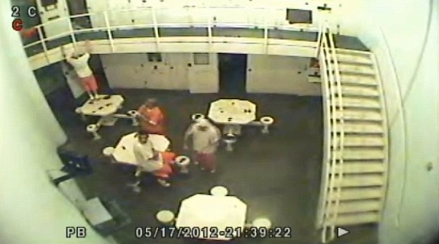 Pre-planned: As the video begins, one of the inmates can be seen signaling to someone in a cell