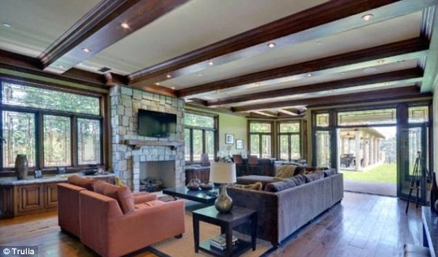 Beam me up: The family room features a more rustic style with beams on the ceilings and a brick fireplace