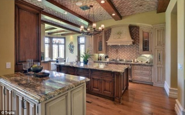 Rustic: The farm-style kitchen does not really fit in with Kim and Kanye's image - despite having all the latest mod cons
