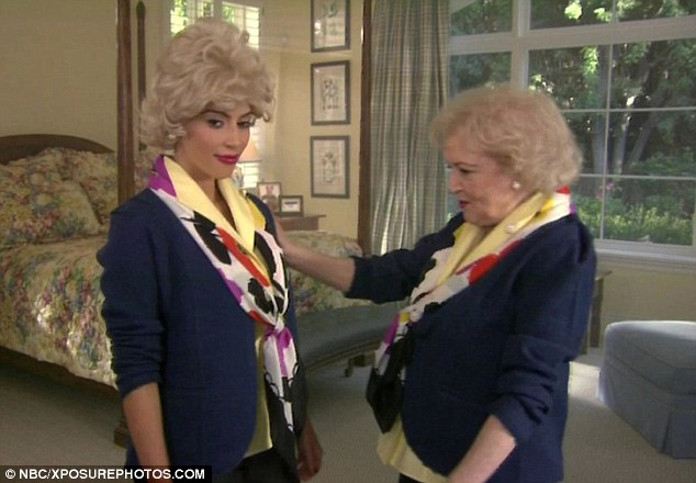 Not her usual style: Betty looks pleased with herself as she makes Kim wear a short blonde wig and dowdy clothing - all in the name of comedy
