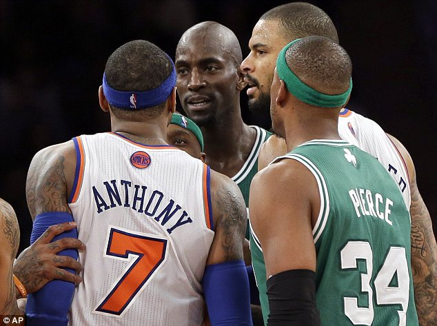 In your face: Carmelo Anthony and Kevin Garnett exchange some harsh words in this photo taken at Madison Square Garden on Monday night