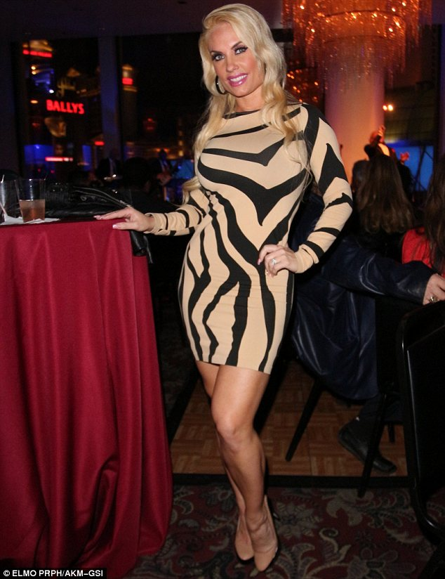 She earned her stripes: Coco teamed the beige and black dress which had animal style stripes with matching two-tone shoes