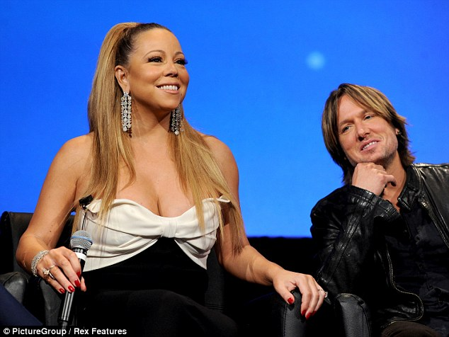 Genuinely nice: Keith listened politely when Mariah spoke into the microphone