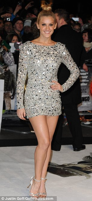 Leggy lady: Ashley Roberts looked sensational in a super short silver dress