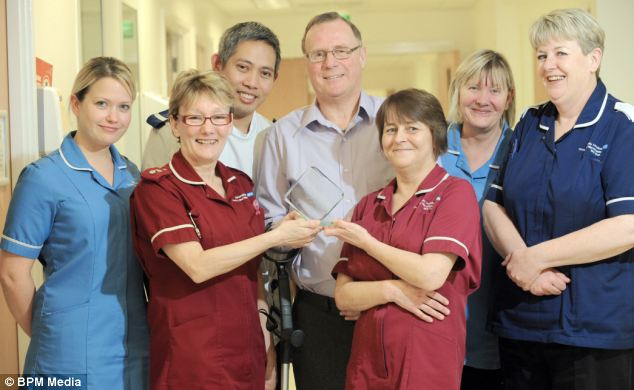 Mr Butler recently presented the nurses at his local hopsital in Covetnry with an trophy, hailing them as 'angels of ward 52'. Left to right: Marie Chinn, Yvonne Bray, Gilbert Mercene, Terry Butler, Penny McGuire, Elaine Gray and Caroline Rudd