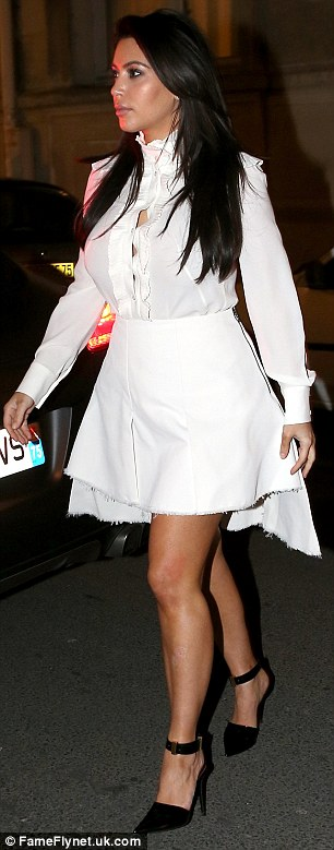 Leggy: Kim also displayed her legs in a matching white miniskirt