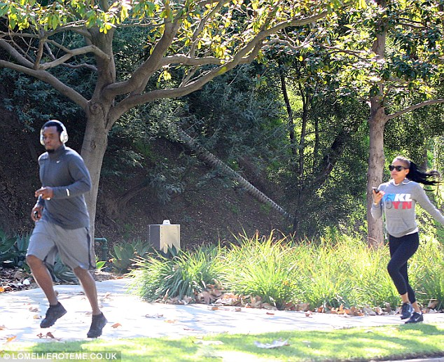 Making a run for it: Perhaps Diddy was in a rush as he did not want his girlfriend Cassie to talk him into getting into a bidding war as they jogged in Beverly Hills on Saturday