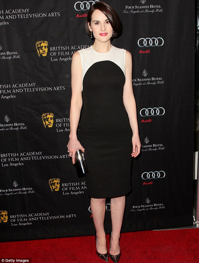 You like like a Lady: Michelle Dockery looked stunning in a black and white dress and heels