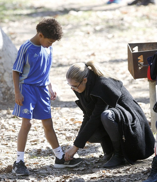 Doting mum: Heidi got down on bended knee to tie the laces of Henry's trainers, which was nice of her