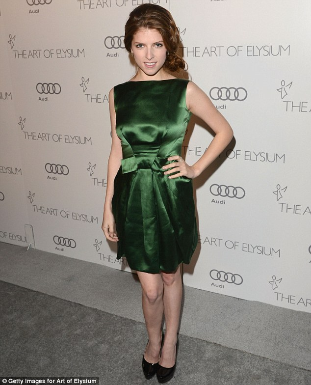Green goddess: Anna Kendrick also opted for a green outfit, in a cute green satin minidress